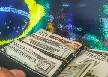 Por que o dólar não caiu com Temer?