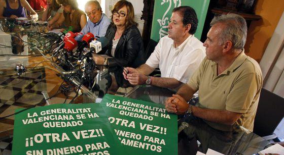 Los representantes de los farmacéuticos de Valencia durante la rueda de prensa del jueves.