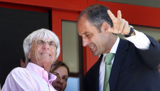 El empresario Ecclestone y el expresidente Camps durante un Gran Premio en Valencia.