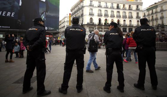 Police officers watching Madrid's central Sol Square on New Year's Eve.