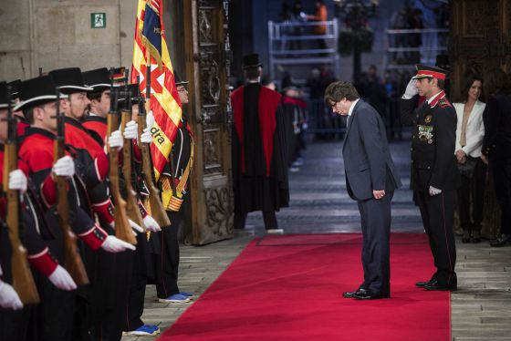 New Catalan premier Carles Puigdemont walks into the Palau de la Generalitat.