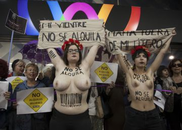 Protesters march against a surrogacy trade fair in a Madrid hotel