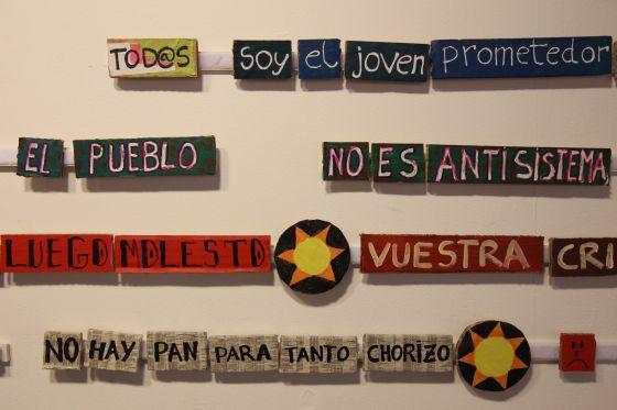 Lemas del movimiento de los indignados, en una exposición sobre el 15-M celebrada en el Ateneo de Madrid en 2012.