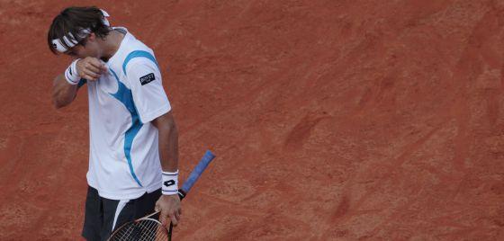 Ferrer se lamenta durante el partido.