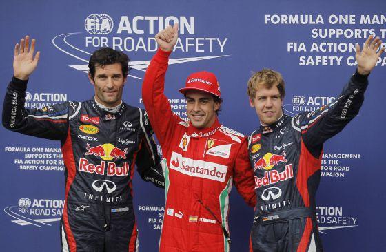 Alonso celebra su pole junto a Webber y Vettel