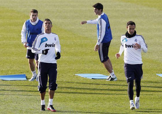 Cristiano, junto a Carvalho en el entrenamiento de ayer.