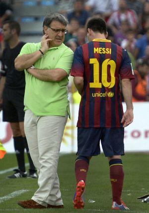 Martino y Messi, tras ser sustituido el argentino