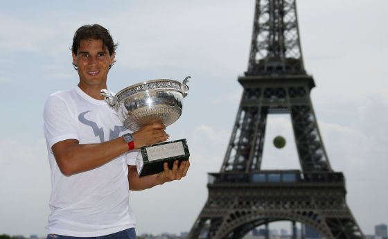 Nadal poses with the Roland Garros trophy in Paris.