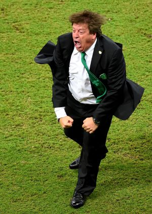 Miguel Herrera celebrates one of Mexico's goals against Croatia.