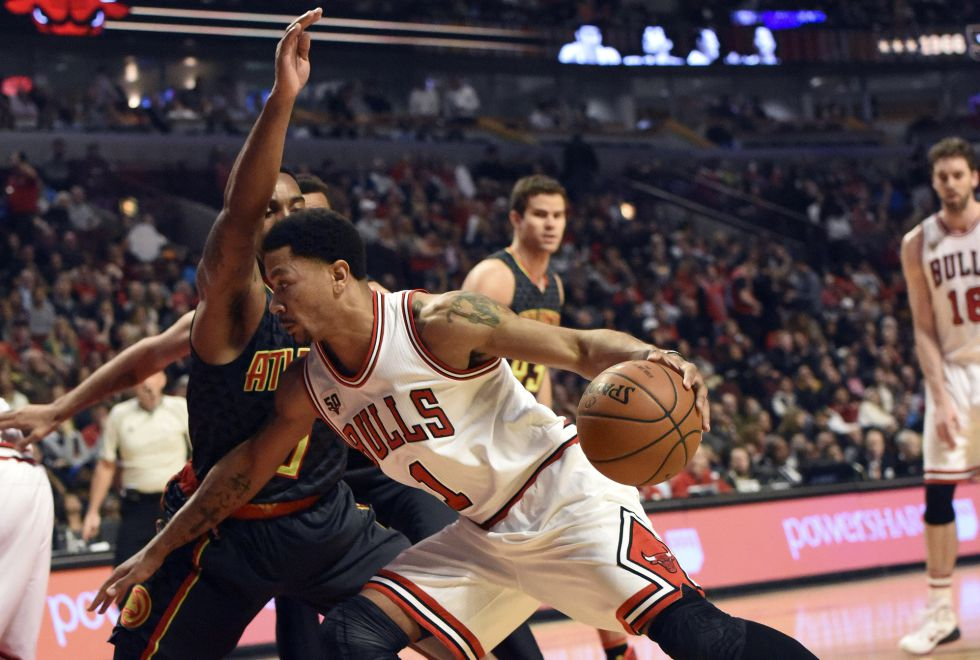 Derrick Rose y Jeff Teague.