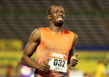 Usain Bolt muestra cara de dolor tras las series de los 100m, el viernes en Kingston.