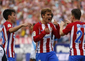 Atletico Madrid's Antoine Griezmann, centre, celebrates with teammates Kevin Gameiro, right, and Nicolas Gaitan after scoring the opening goal against Deportivo Coruna during the Spanish La Liga soccer match between Atletico Madrid and Deportivo at the Vicente Calderon stadium in Madrid, Sunday, Sept. 25, 2016. Griezmann scored once in Atletico's 1-0 victory. (AP PhotoFrancisco Seco)