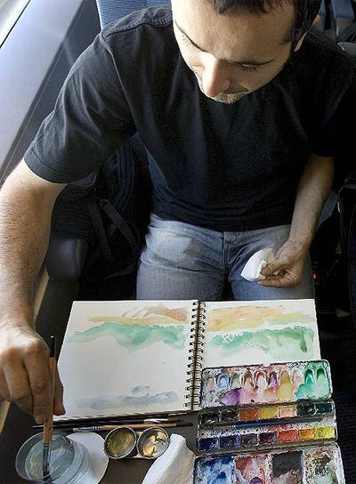 Un dibujante en el AVE a Madrid.