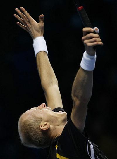 Nikolay Davydenko celebra su triunfo sobre Juan Martín del Potro en la Copa de Maestros.
