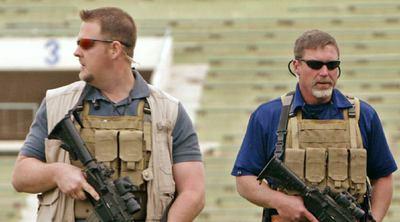 Empleados de una empresa privada de seguridad, durante un acto celebrado en Bagdad en 2004.