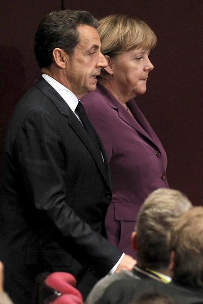 Nicolas Sarkozy y Angela Merkel, durante la cumbre del G-20 en Cannes, el 2 de noviembre.