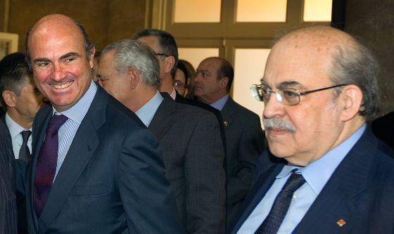 El ministro de Economía, Luis de Guindos, y el conseller catalán del ramo, Mas-Colell.