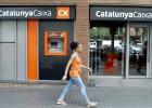Las cajas ganan un 71% menos, lastradas por CatalunyaCaixa