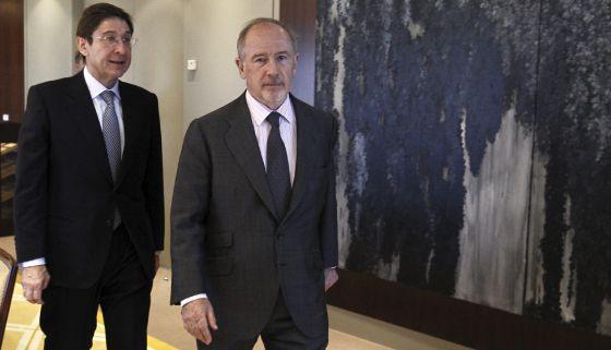 El presidente de Bankia, Goirigolzarri, y su antecesor Rodrigo Rato.
