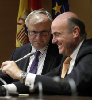 El ministro de Economía y Competitividad, Luis de Guindos, y el comisario de asuntos económicos de la Comisión Europea, Olli Rehn