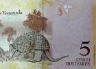 Venezuela devalúa el bolívar casi un 32% pese a la ausencia de Chávez