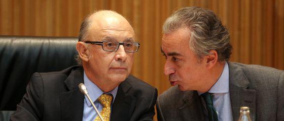 El ministro de Hacienda, Cristóbal Montoro y el secretario de Hacienda, Miguel Ferre.