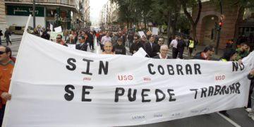 Protesta de trabajadores para exigir sus salarios.