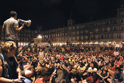 Protestors in Madrid's Plaza Mayor on Tuesday night, after police stopped them from accessing Sol square.