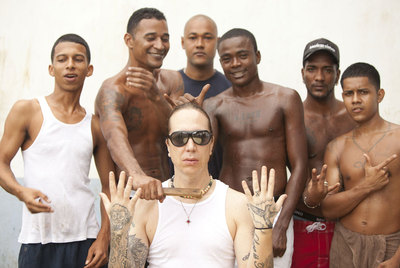 Ángel Francisco López Morán, better known as DJ Professor Angel Dust, surrounded by some of his fellow-inmates in Panama's El Renacer prison.