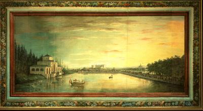 Pintura anónima de 1816 que reproduce el estanque del Retiro, con el edificio de la Real Fábrica de Porcelana al fondo.