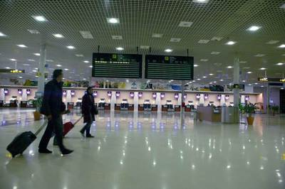 Two passengers walk through the ticketing area at the Reus airport in Tarragona.