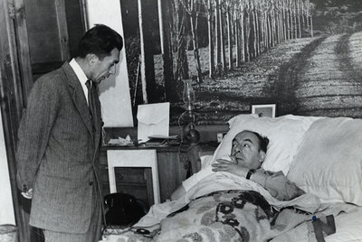 Manuel Araya speaks to Neruda (in bed) in a Santiago hospital in 1973.