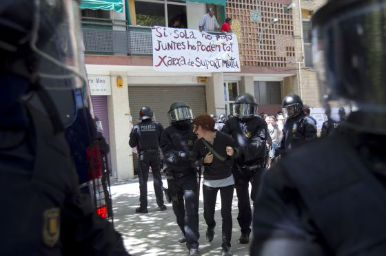 Catalan police dislodge a protestor at an eviction last year in Clot, Barcelona.