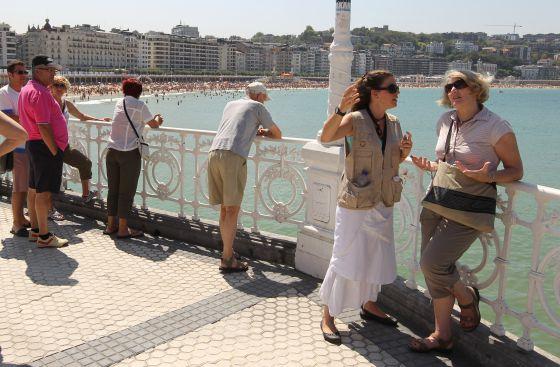People by the seaside in San Sebastián.