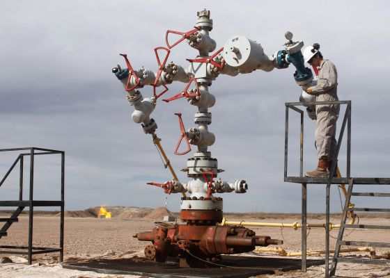 A worker measures pressure at Vaca Muerta, Repsol's expropriated oil field in Argentina.