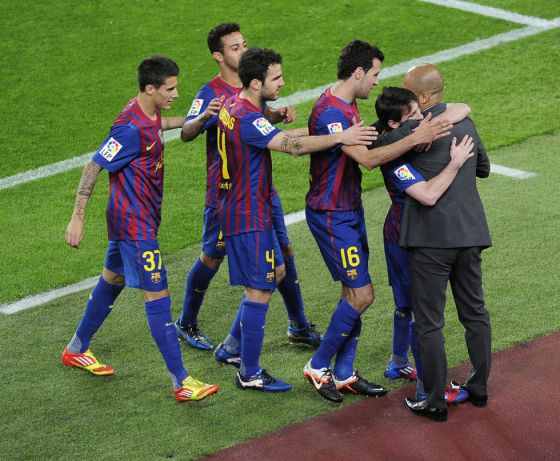 Leo Messi embraces Pep Guardiola after scoring against Espanyol.