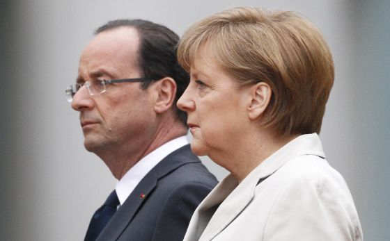French president François Hollande and German Chancellor Angela Merkel together at their first official meeting last month.