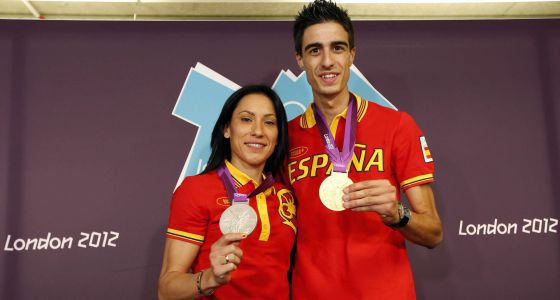 Brigitte Yagüe and Joel González show off their medals.