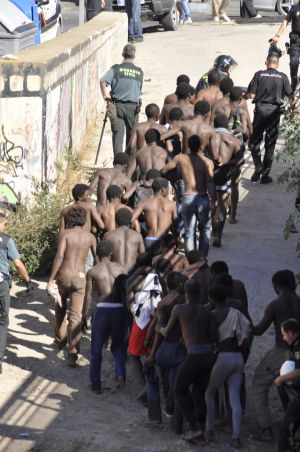 Sub-Saharan migrants captured after jumping into Melilla.