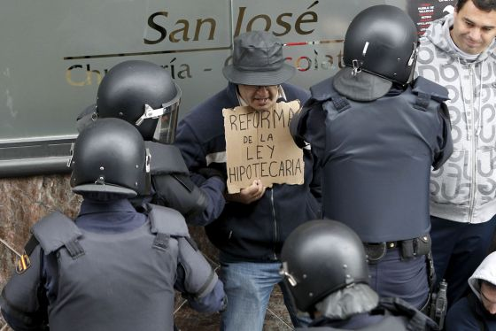 Police detain a man protesting at an eviction in Torrejón de Ardoz, Madrid, in November 2011.