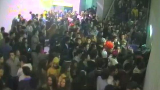 A still image from a security camera at Madrid Arena shows a large number of people trying to access the dance floor via a narrow corridor.