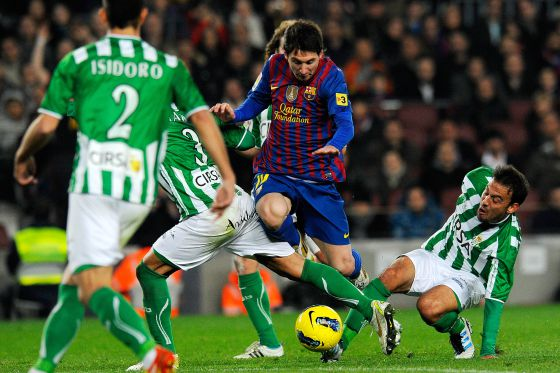Leo Messi takes the ball round the Betis defense during the teams' Liga meeting in January.