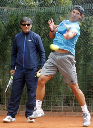 Nadal training with his coach and uncle, Toni.