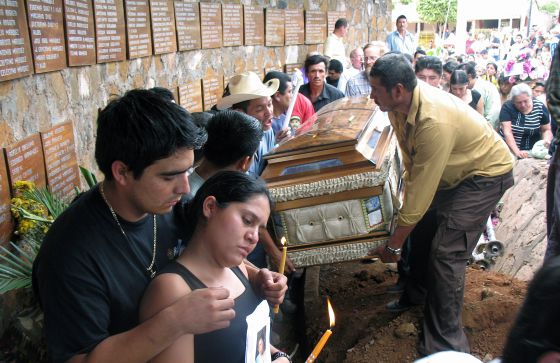 Relatives of Rufina Amaya, the sole survivor of the 1981 El Mozote massacre, carry her coffin after her eventual death in 2007.