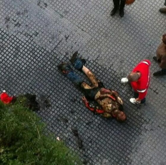 A man lies in the street in Málaga after setting himself on fire.