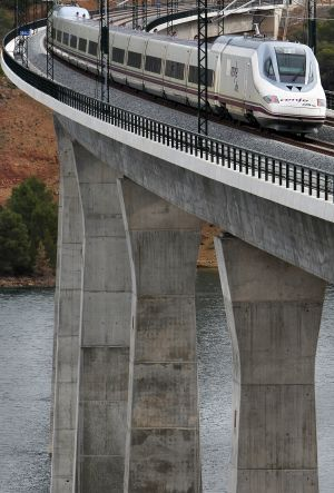 The Madrid-Valencia high-speed train passing through one of the viaducts.