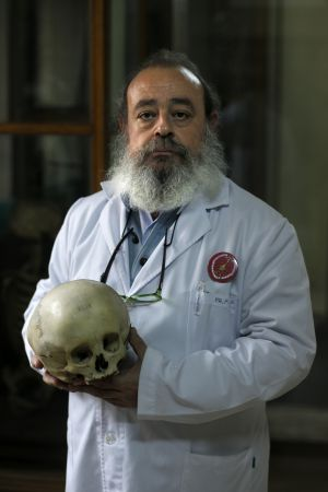 Fermín Viejo holds one of the museum's 2,000 skulls.