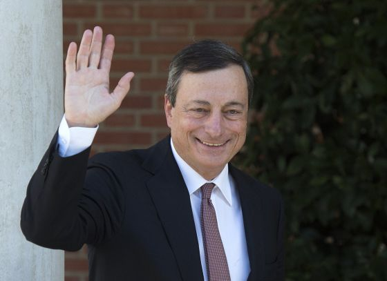 Mario Draghi waves before a meeting at La Moncloa prime ministerial palace in Madrid.
