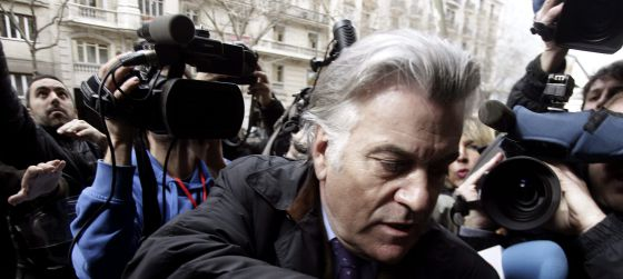 Former Popular Party treasurer Luis Bárcenas is met by media scrum as he arrives at his home in Madrid.