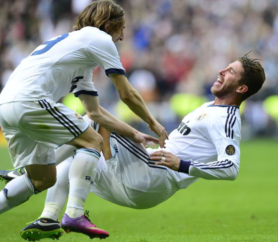 Real Madrid defender Sergio Ramos (r) celebrates with Real Madrid's Croatian midfielder Luka Modric after scoring the second goal against Barcelona.